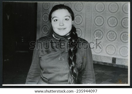 Ussr - CIRCA 1970s: An antique Black & White photo show young woman