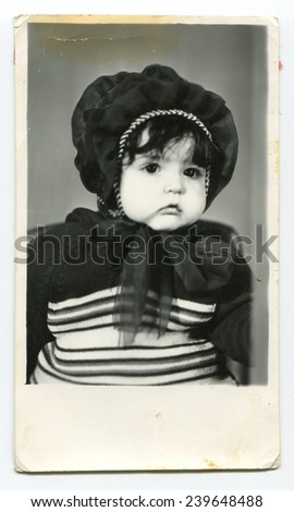 USSR - CIRCA 1980s: An antique photo show studio portrait  little girl in an interesting hat - stock photo