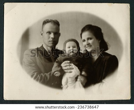 USSR - CIRCA 1950s : An antique photo shows family portrait: mother, father and baby