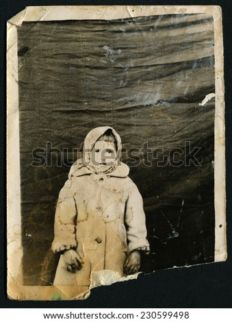 USSR - CIRCA 1960s: An antique photo shows little girl in a fur coat, circa 1960s - stock photo