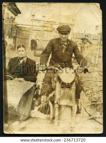 USSR - CIRCA 1970s: An antique photo shows Man and woman riding on a motorcycle, USSR, circa 1970s