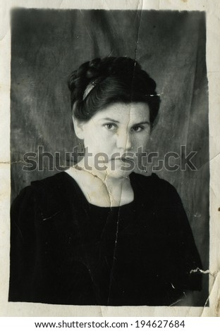 USSR - CIRCA 1950s: An antique photo shows studio portrait of a woman, USSR, circa 1950s