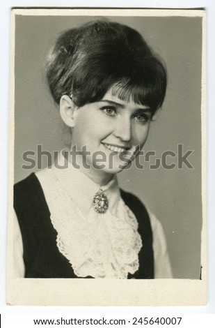 USSR - CIRCA 1970s: studio Portrait young woman with a lovely smile, circa 1970s