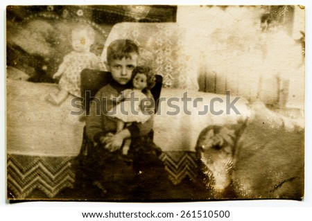 USSR - CIRCA 1980s: Vintage photo of little boy with a doll - stock photo