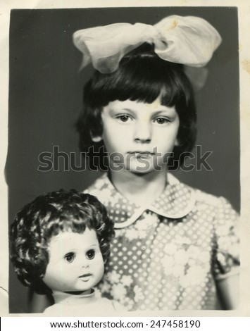 USSR - CIRCA 1980s: Vintage photo of little girl with a doll - stock photo