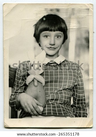 USSR - CIRCA 1980s: Vintage photo of little girl with a hare - stock photo