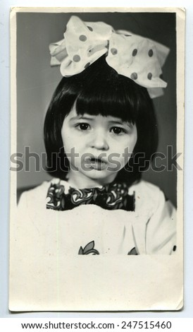 USSR - CIRCA 1980s: Vintage photo of little girl with bow - stock photo
