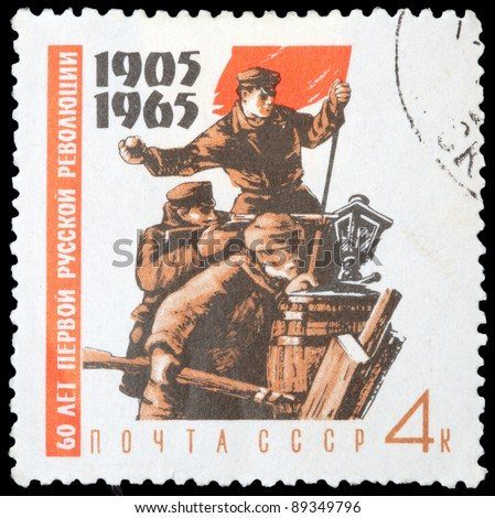 USSR - CIRCA 1965: stamp printed by USSR, shows Fighters on barricades with red flag, circa 1965