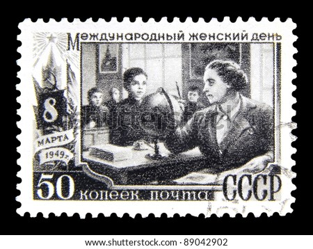 "USSR - CIRCA 1949: stamp printed in the USSR (Russia) shows a woman teacher with inscription ""International Women's Day March 8, 1949"" from the series ""International Women's Day March 8"", circa 1949"