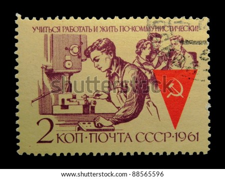 "USSR - CIRCA 1961: stamp printed in the USSR (Russia) shows Collective working with the inscription ""Learn, work and live in a communist"" from the series ""The collective of communist labor"",circa 1961"