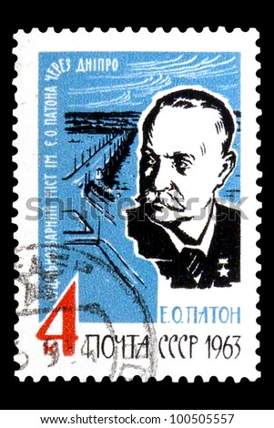 "USSR - CIRCA 1963: stamp printed in USSR (Russia) shows portrait of Evgen Paton with the inscription ""Welded Paton Bridge across Dnieper"", series ""10th Death Anniversary of E. O. Paton"", circa 1963"