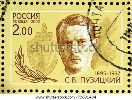 """USSR - CIRCA 2002: stamp printed in USSR shows portrait of S. V. Puzitsky (1895-1937) with inscription in block """"Outstanding agents 1922 - 1937"""", series 80 years of Soviet secret service, circa 2002 - stock photo"""