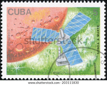 USSR - CIRCA 1988: The postal stamp printed in USSR is shown by the sputnik on a green hum about a red planet, CIRCA 1988. - stock photo