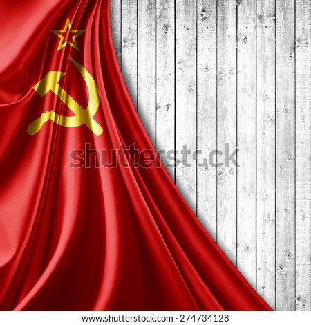 Ussr flag of fabric and wood background - stock photo