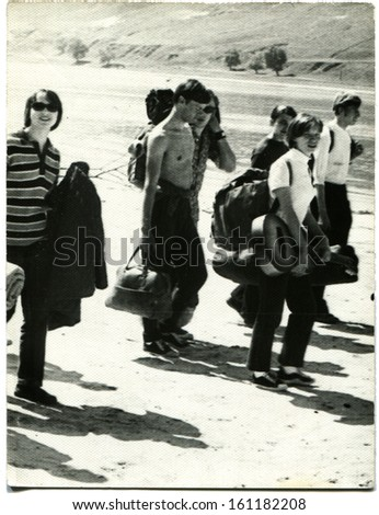 USSR - 1972: group of young people go to hike, city Shakhty, Rostov Oblast, Russia, USSR, 1972