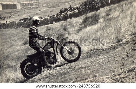 USSR, Russia - CIRCA 1960s: An antique Black & White photo of a Motorcyclist on the competition at motorcycle race. - stock photo