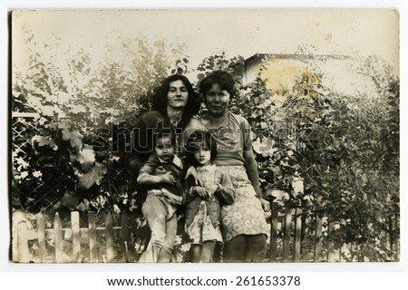 USSR - 1950s: An antique photo shows two women with two daughters standing in the garden