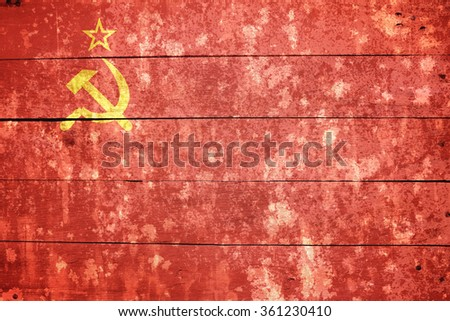 USSR, Soviet flag on old wood textured background - stock photo