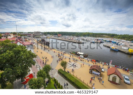 USTKA - JULY 29: Promenade along the beach with the walking vacationing people on 29 July 2015 in Ustka, Poland, The view from the lighthouse.