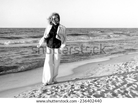 USTKA,POLAND - circa 1974:vintage photo of young woman on beach in summer
