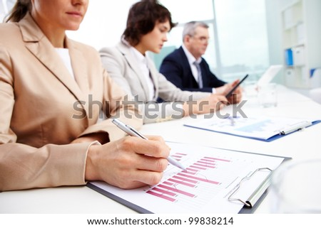 Usual working day at office, business people concentrating on work - stock photo