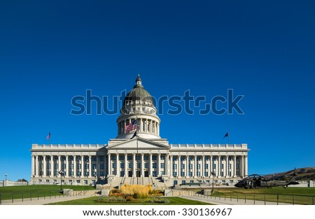 Utah state capitol building with a helicopter
