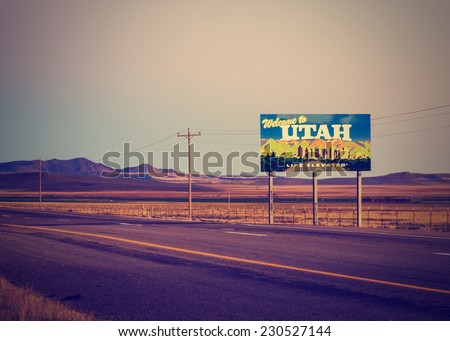 utah state line welcome sign with open landscape with retro instagram filter - stock photo