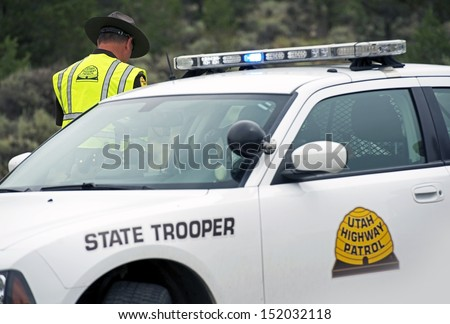 Utah State Trooper Cruiser. Police Car and Trooper. Police Photo Collection. - stock photo