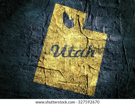 Utah state yellow outline map on grunge dark blue background with state name