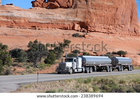 UTAH, UNITED STATES - JUNE 23, 2013: Tanker truck drives in rural Utah, United States. Trucking industry accounts for 69 percent of all freight transport in the USA. - stock photo