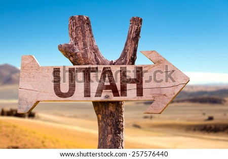 Utah wooden sign with a desert background - stock photo