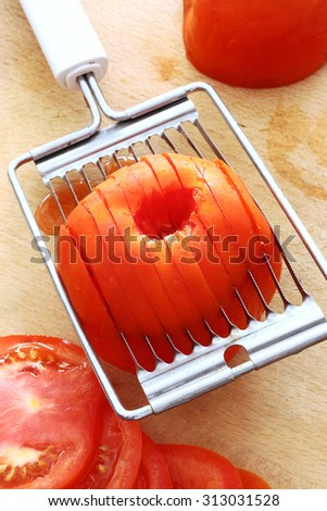 utensil for slicing tomatoes, close up - stock photo