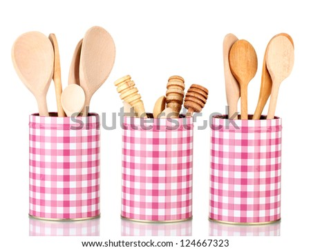 Utensils in metal containers isolated on white
