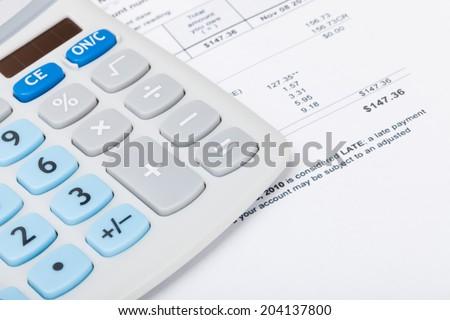 Utility bill with calculator - stock photo