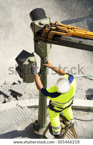 utility electrician worker of service company to repair traffic lights in  city - stock photo
