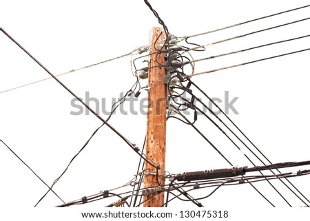 Utility pole hung with electricity power cables for residential supply - stock photo