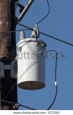 Utility pole with transformers - stock photo