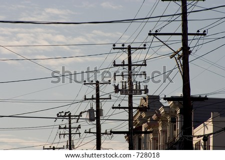 Utility polls and wires clog the sky in a San Francisco neighborhood.
