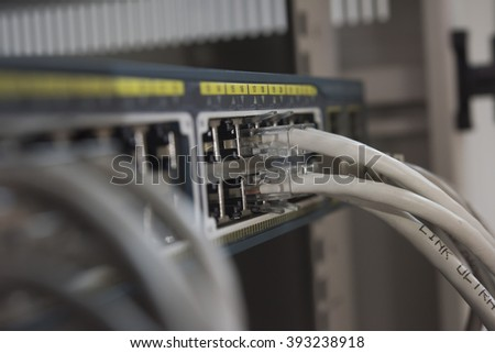 UTP  Cable connected Network switch close up for transfer data and information - stock photo