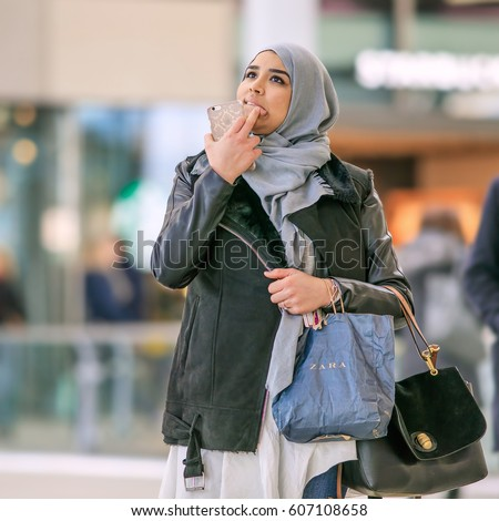 UTRECHT-MARCH 2, 2017. Islamic girl with a headscarf.  Head coverings are common in Islamic countries. Women who live outside these countries are not usually required to wear it, but many still do.