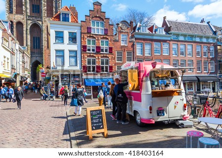 Utrecht, Netherlands - April 20, 2016: street scene in the old town with unidentified people. The university city Utrecht is the 4th largest city of Netherlands and capital of the same named province - stock photo