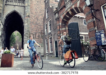 Utrecht,Netherlands-July 17th, 2013 : Vintage tone color photography of people on bicycle in the old city of Utrecht