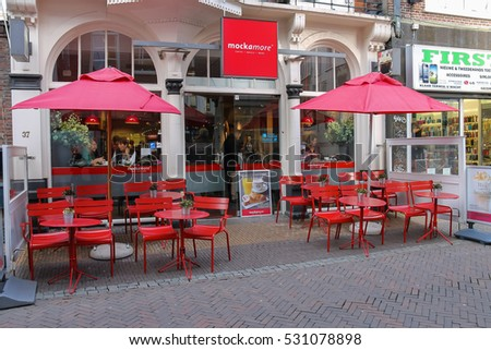 Utrecht, the Netherlands - February 13, 2016: People resting in cafe in the historic city centre