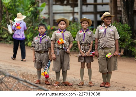UTTARADIT, THAILAND, JULY 11, 2013: Thai boyscouts are posing early morning in a countryside district of Uttaradit, Thailand - stock photo