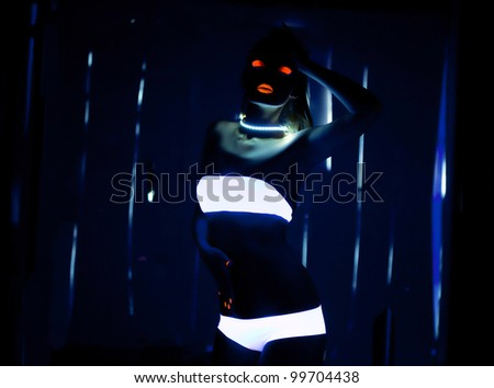UV-light and special glow make-up - stock photo