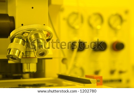 UV Mask-aligner in the cleanroom for semiconductor processing (in yellow room) - stock photo
