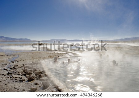 UYUNI, BOLIVIA / September 28, 2011, National Reserve of Sur Lipez Province, Bolivia, South America. People enjoying a natural hot water pool in the mountains of Bolivia. EDITORIAL