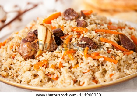Uzbek national dish pilaf on plate