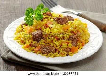 Uzbek national dish plov on plate - stock photo