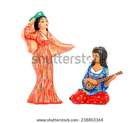 Uzbek national figurines (hand-made) isolated.